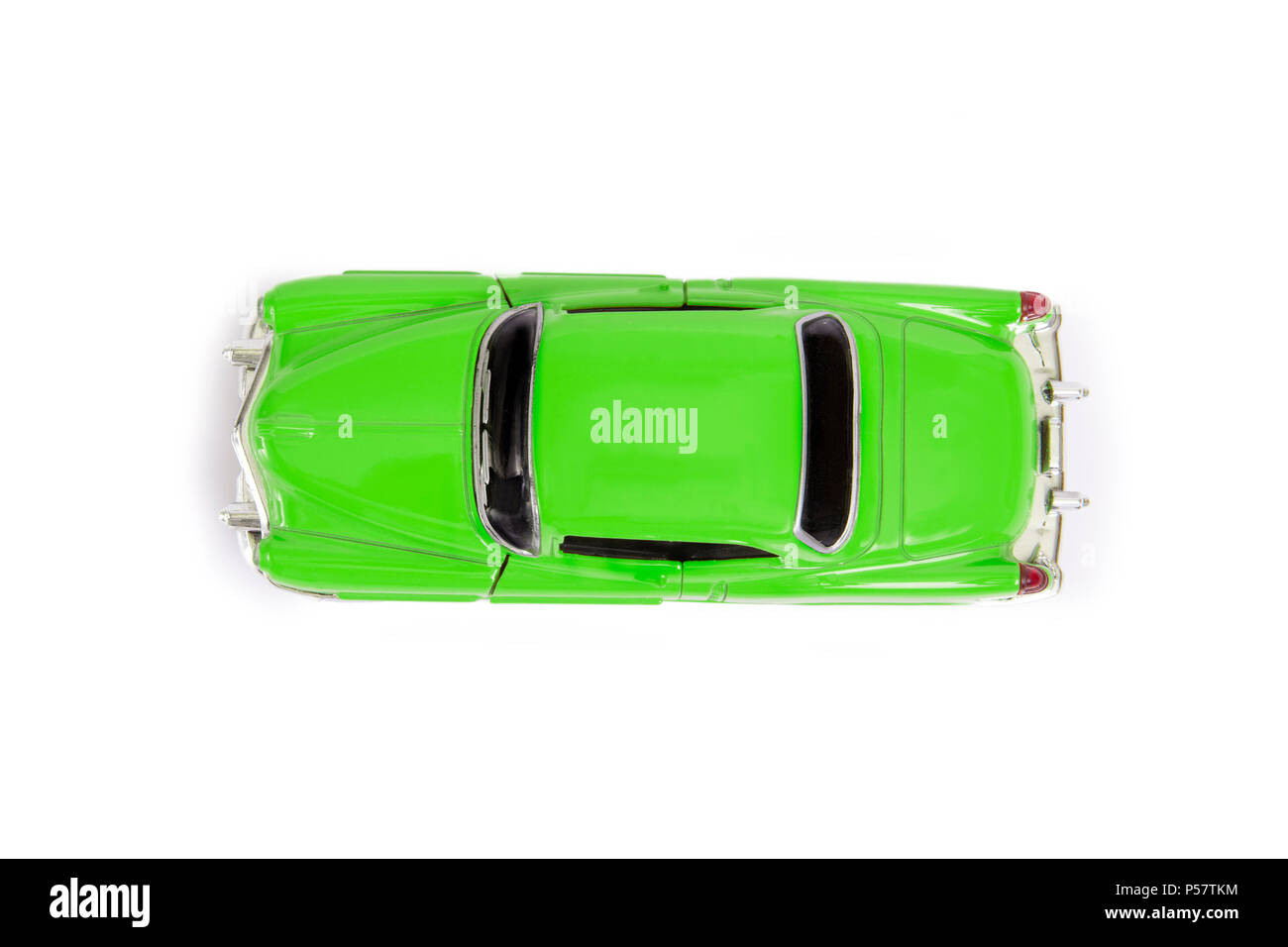 Top view of green model toy car in retro style on white background. - Stock Image