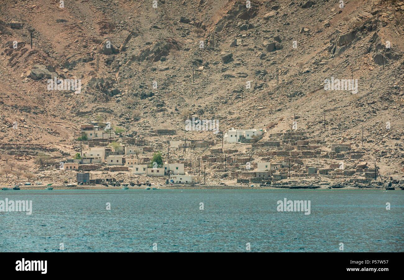 small fisherman village in Hajar Mountains of Musandam, Oman - Stock Image