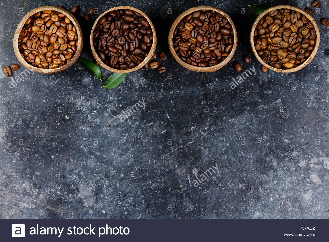 Four different varieties of coffee beans - Stock Image