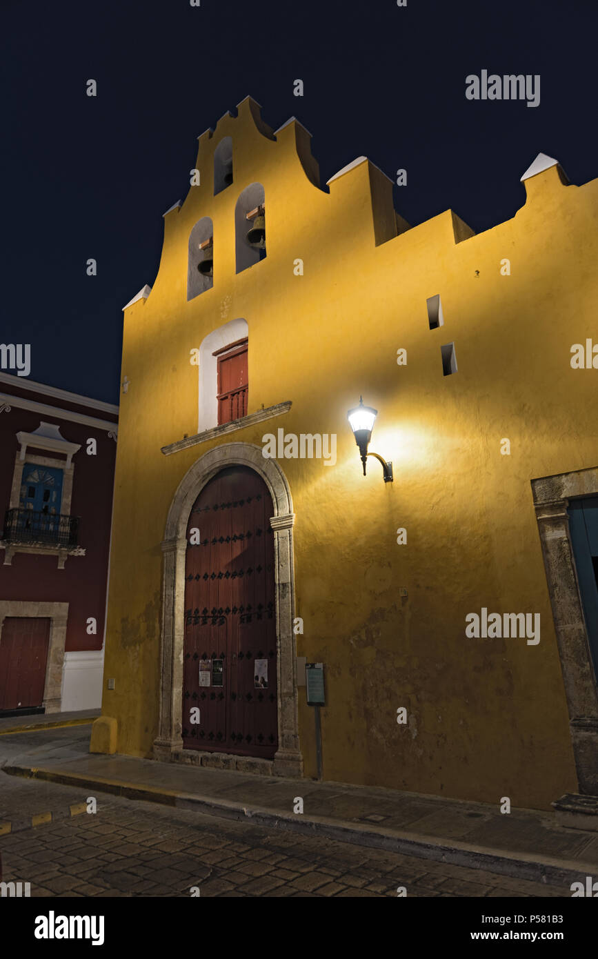 yellow church in colonial style at night in san francisco de campeche, mexico Stock Photo