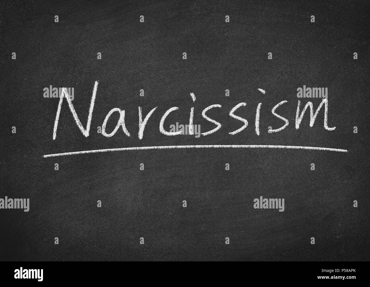 narcissism concept word on a blackboard background - Stock Image