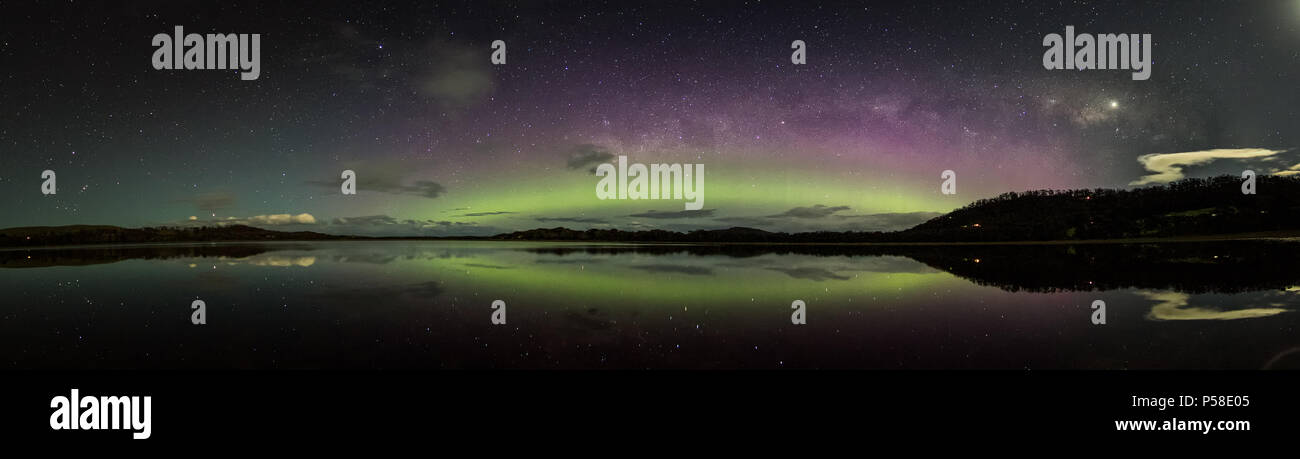 Aurora arc and Milky Way with reflections - Stock Image