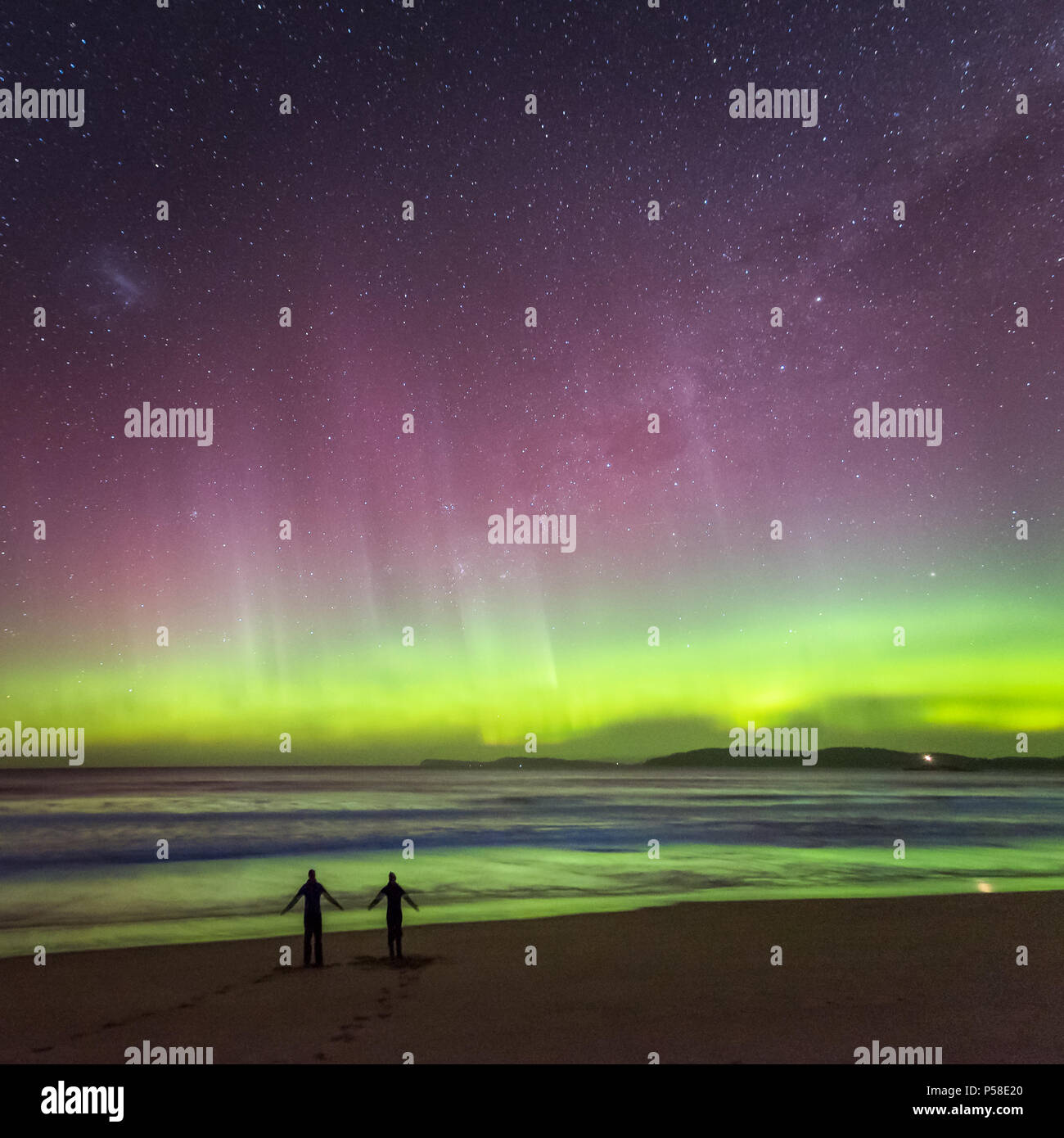 Couple dancing on the beach under the Aurora - Stock Image