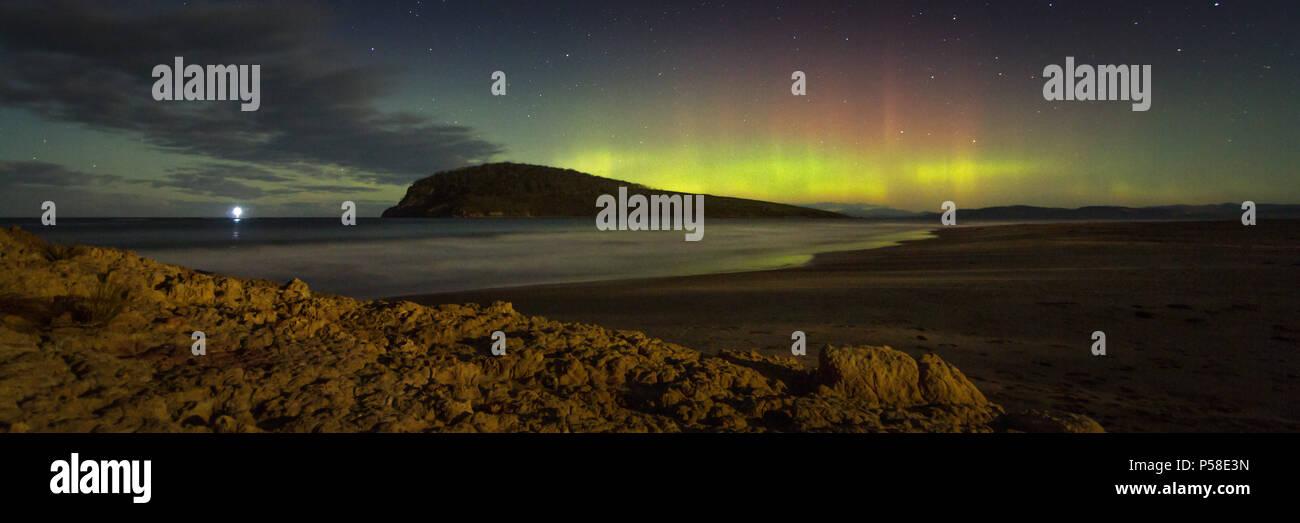 Aurora Australis over moonlit beach - Stock Image