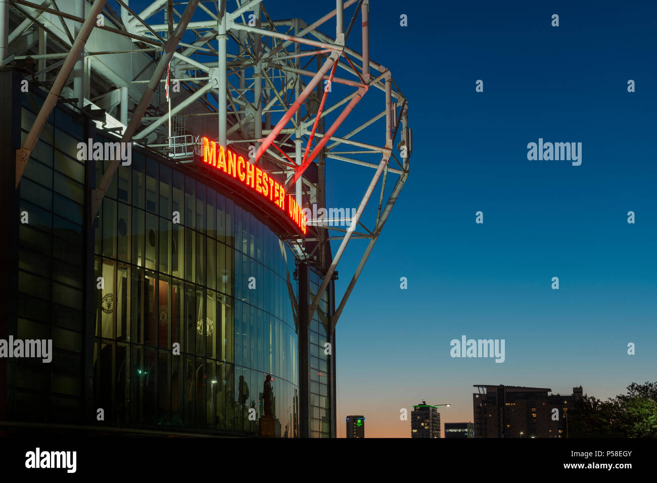 Old Trafford stadium, home of Manchester United Football Club, during a summer's evening (Editorial use only). - Stock Image
