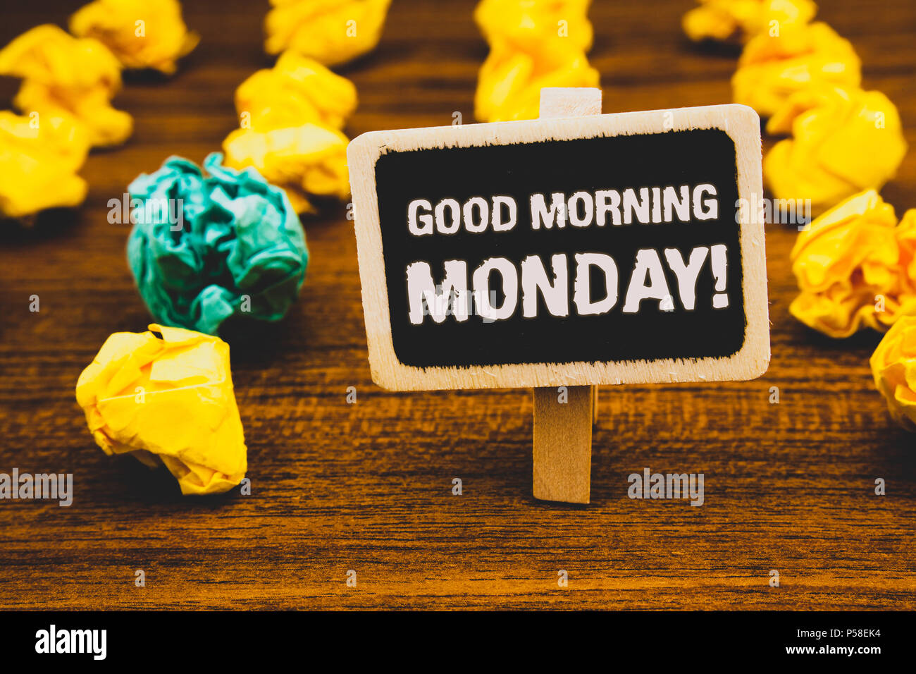 Text sign showing Good Morning Monday Motivational Call. Conceptual photo Happy Positivity Energetic Breakfast Blackboard with letters wooden floor bl - Stock Image