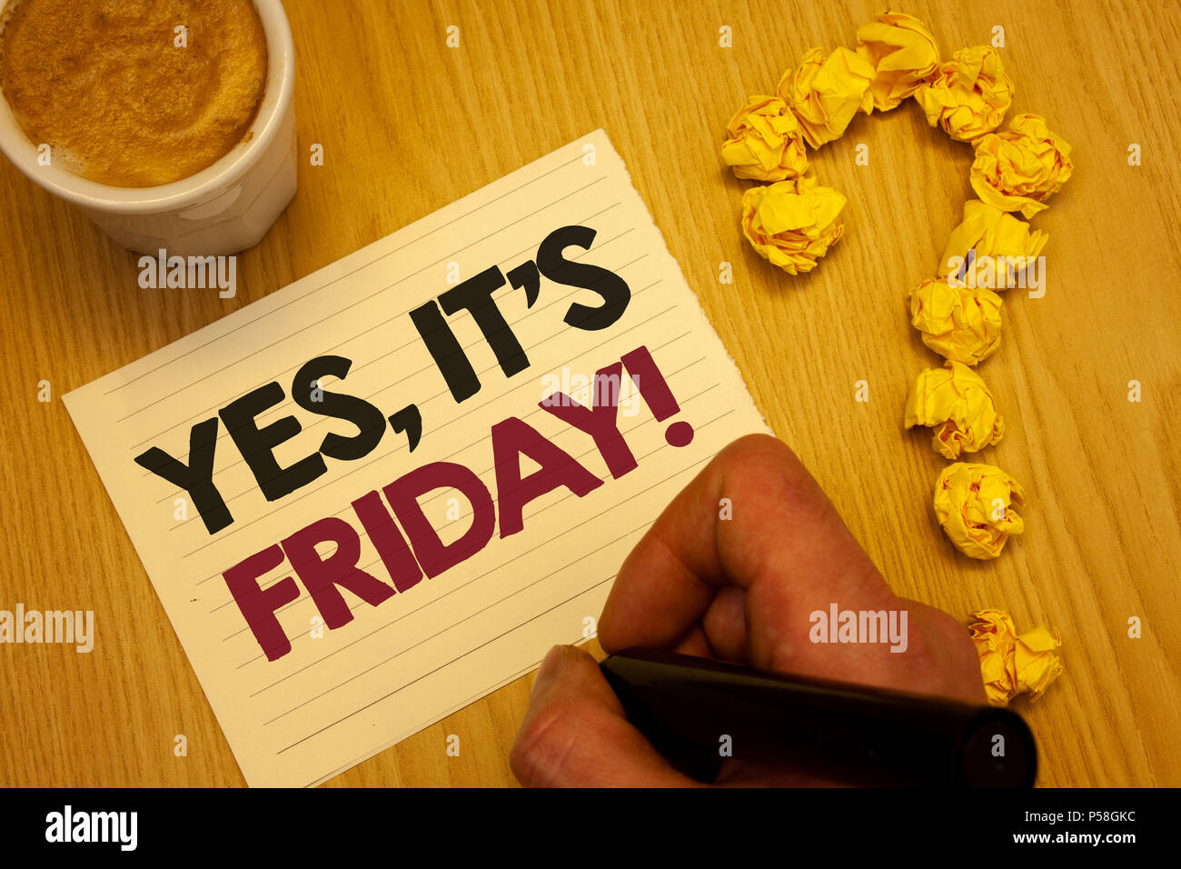 Conceptual hand writing showing Yes, It'S Friday Motivational Call. Business photo showcasing having weekend Taking rest break Wooden desktop hand hol - Stock Image