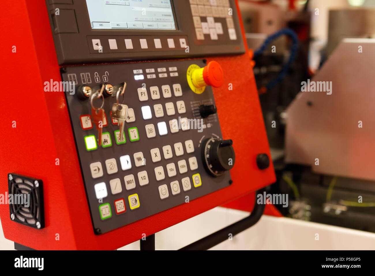 Control panel of metalworking CNC machinery. Selective focus. - Stock Image