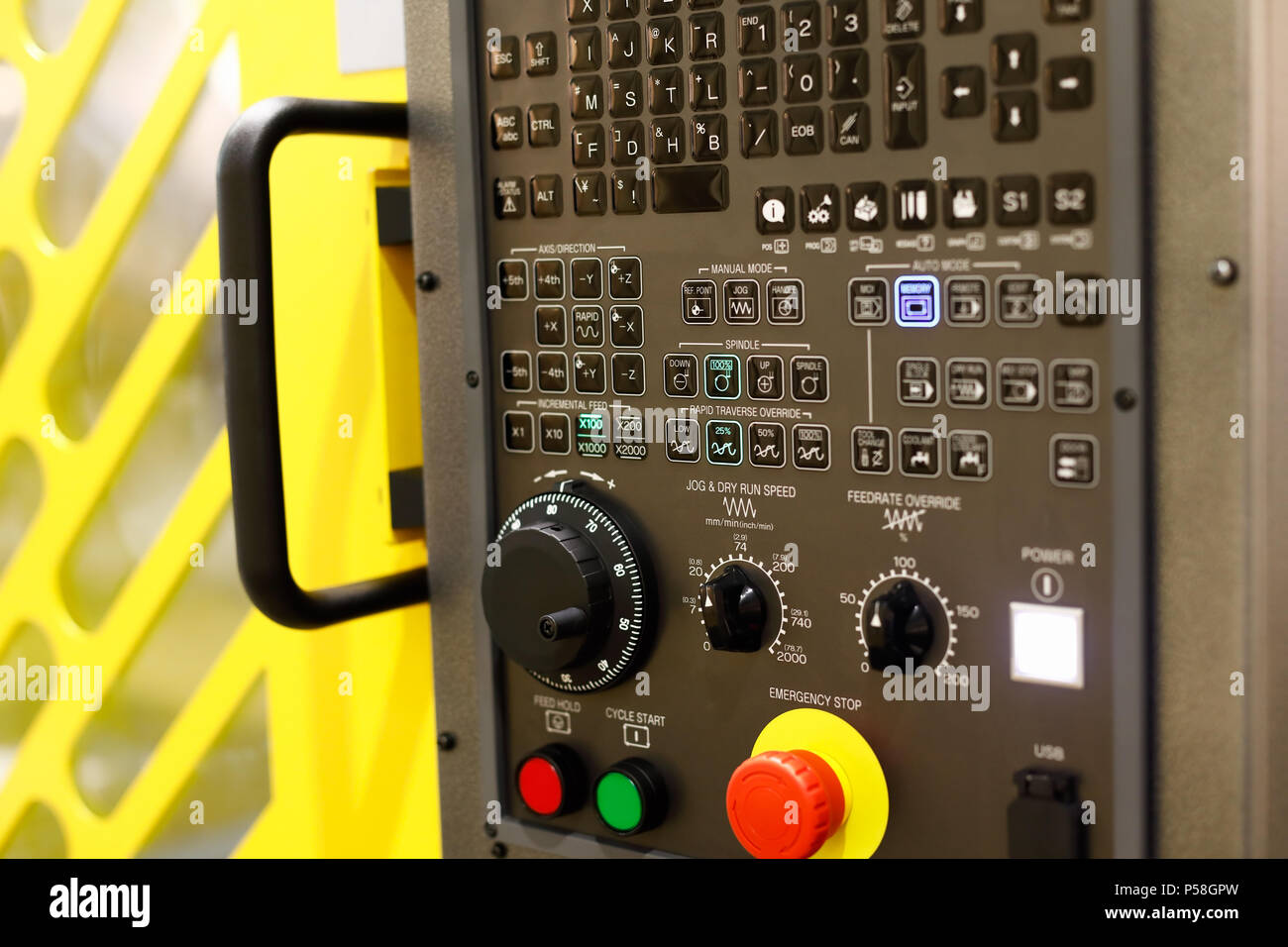 A control panel of modern 5-axis CNC lathe machine. Selective focus. - Stock Image