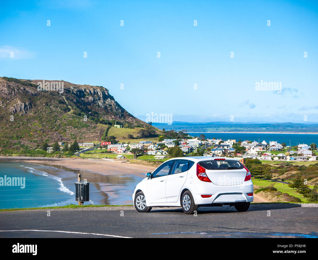 Car parked on hill with a stunning view of The Nut -- a volcanic plug in the town of Stanley at front. Stanley, Tasmania, Australia - Stock Image