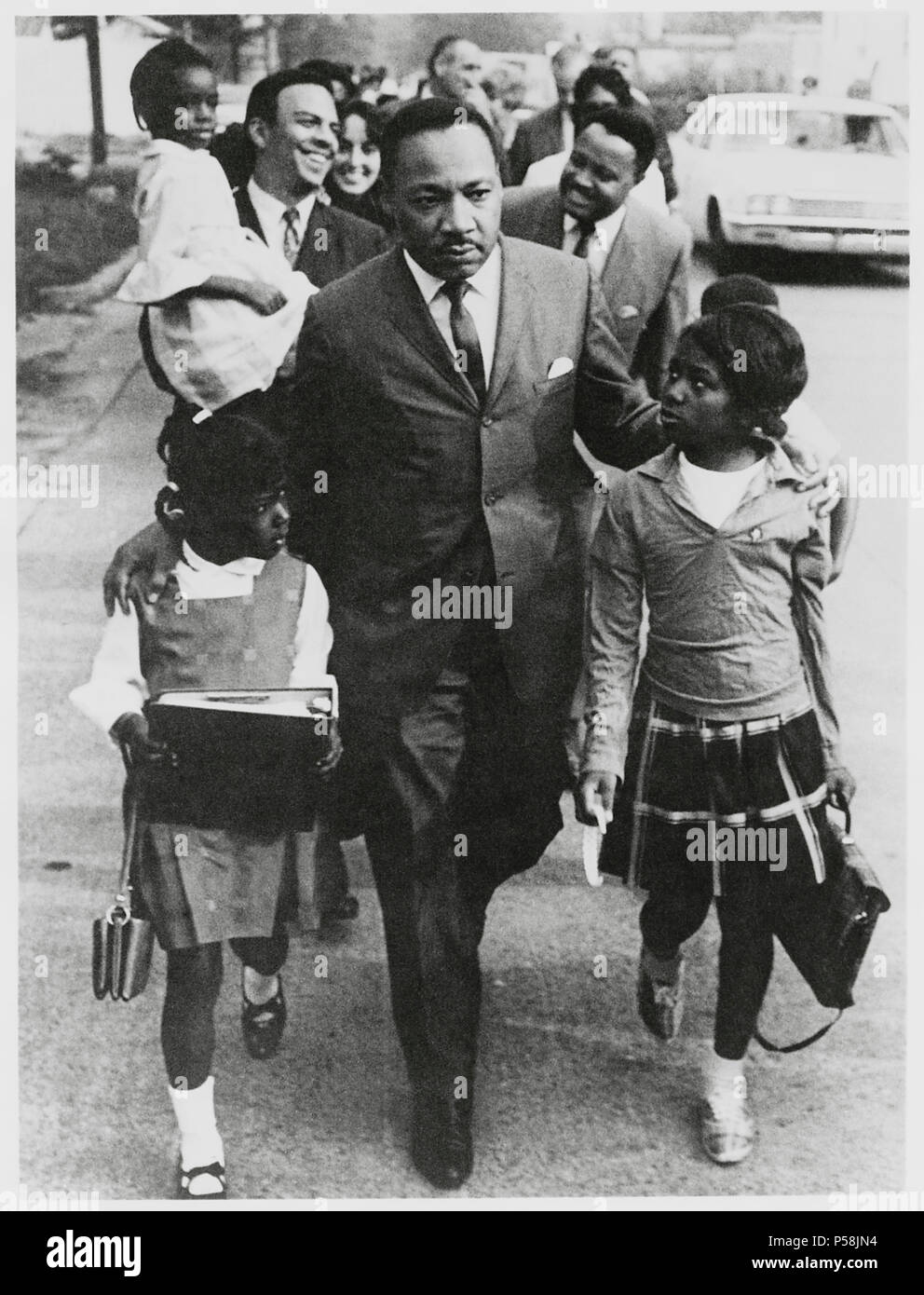 Martin Luther King Jr Escorting Schoolchildren To Newly Integrated