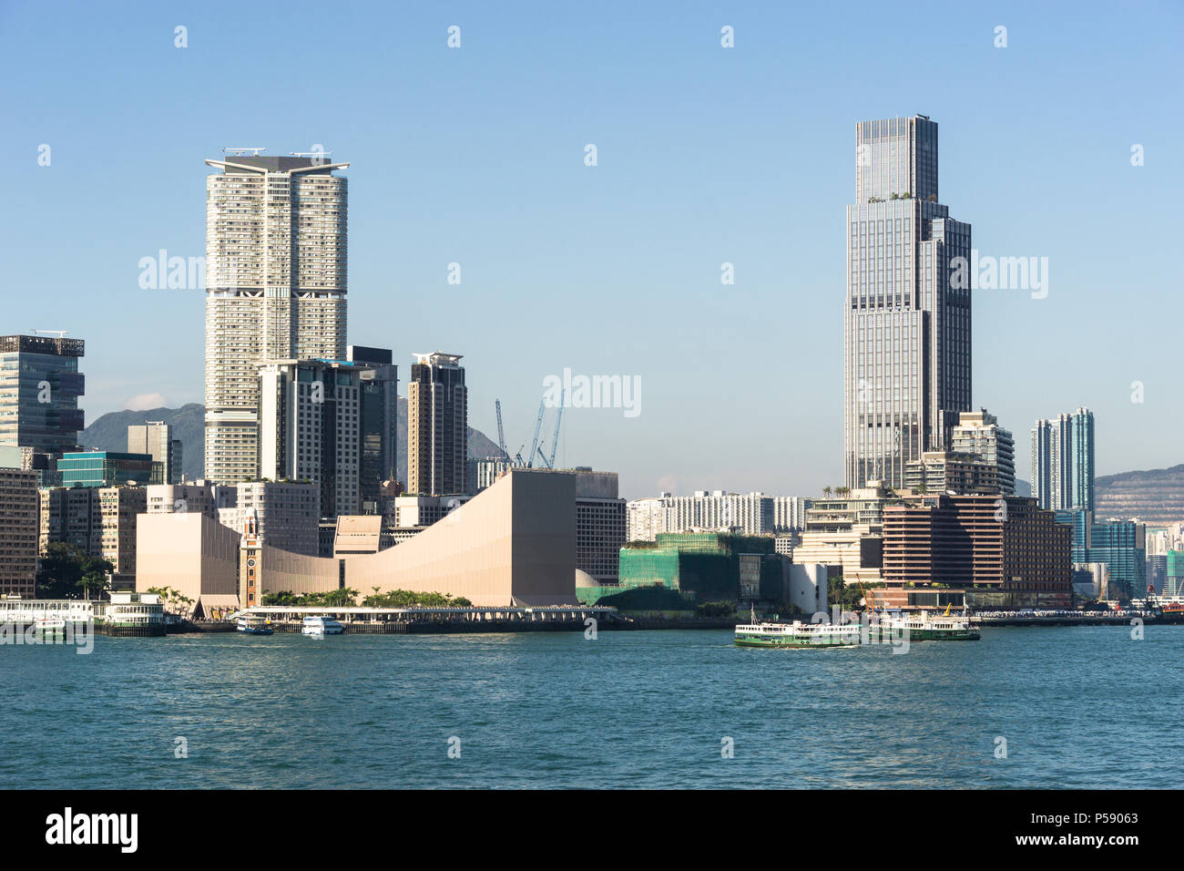 Kowloon skyline at Tsim Sha Tsui view from across the Victoria harbour in Hong Kong on a sunny day in China SAR. Stock Photo
