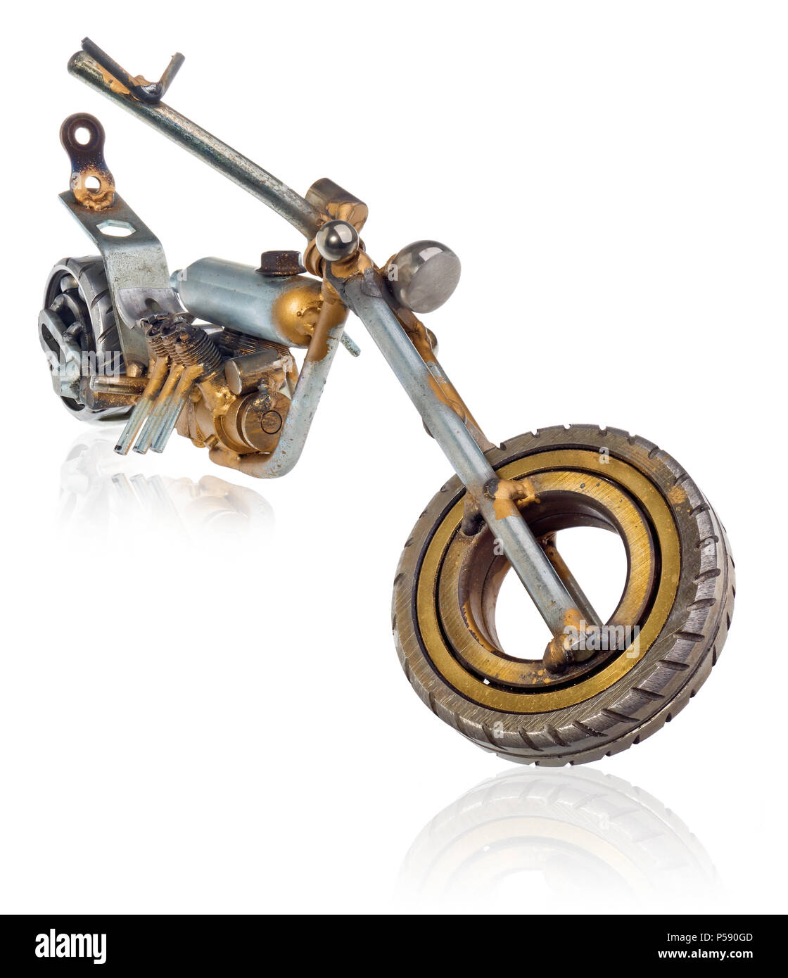 Handmade miniature of a chopper motorcycle. Decorative vehicle made of mechanical parts, bearings, wires, car candles, screws, plates. Toy in silver-g Stock Photo