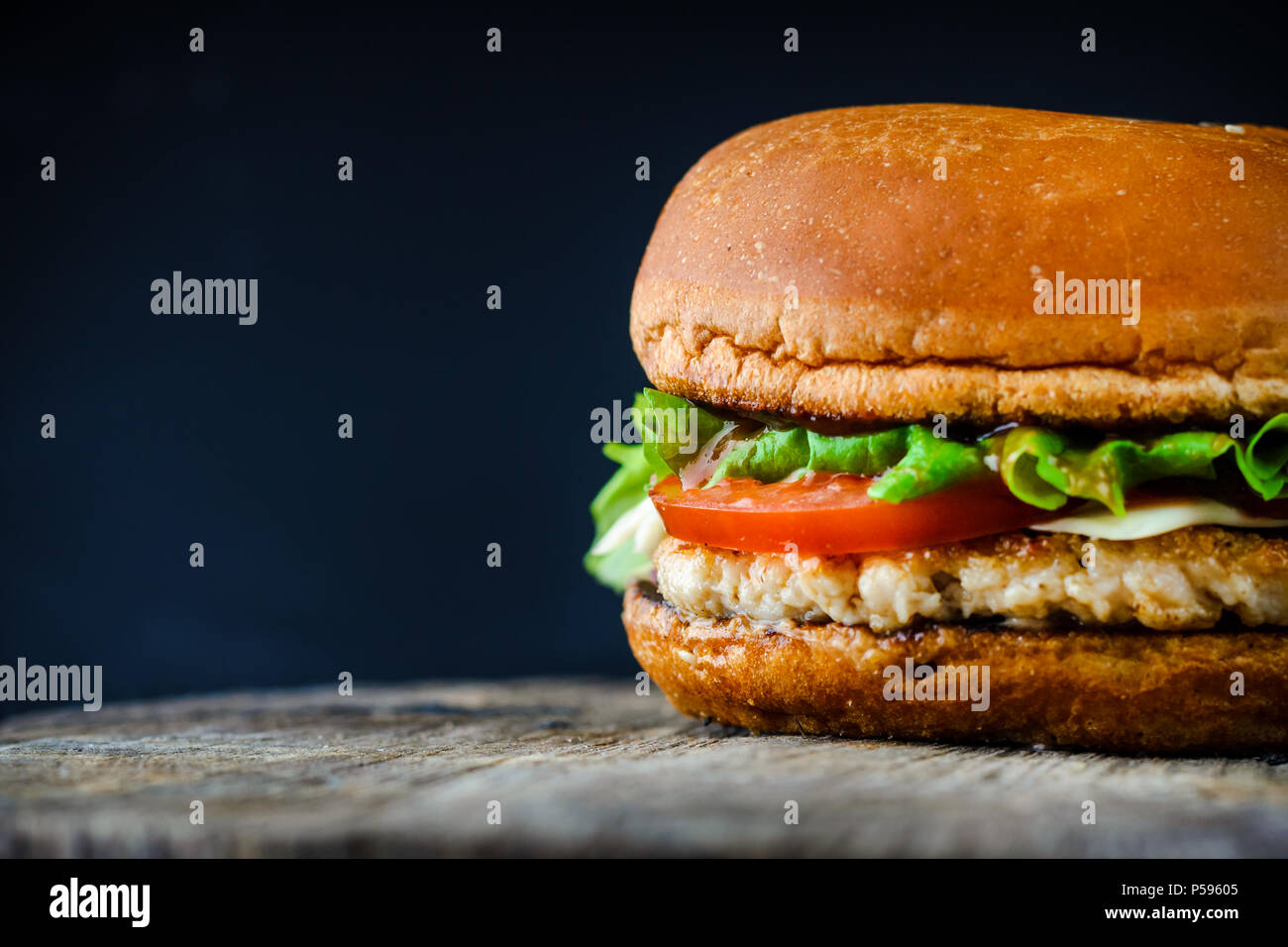 Homemade Appetizing Chickenburger On Dark Background With Copy Space