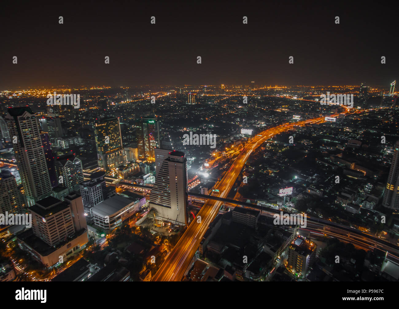 Bangkok, Thailand - one of the main attractions of Bangkok are the rooftop bars, from which is possible to have a stunning view of the city - Stock Image