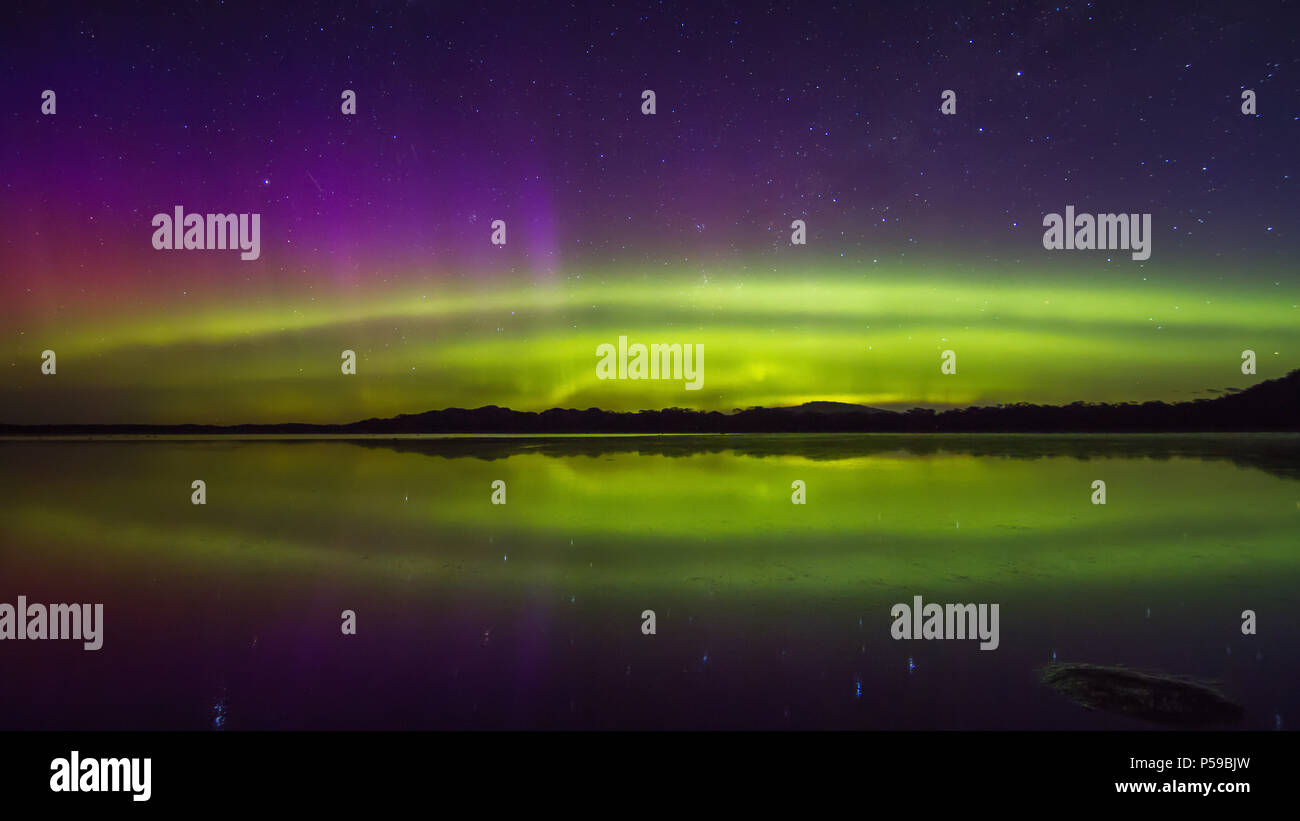 Colourful Aurora display with reflections - Stock Image