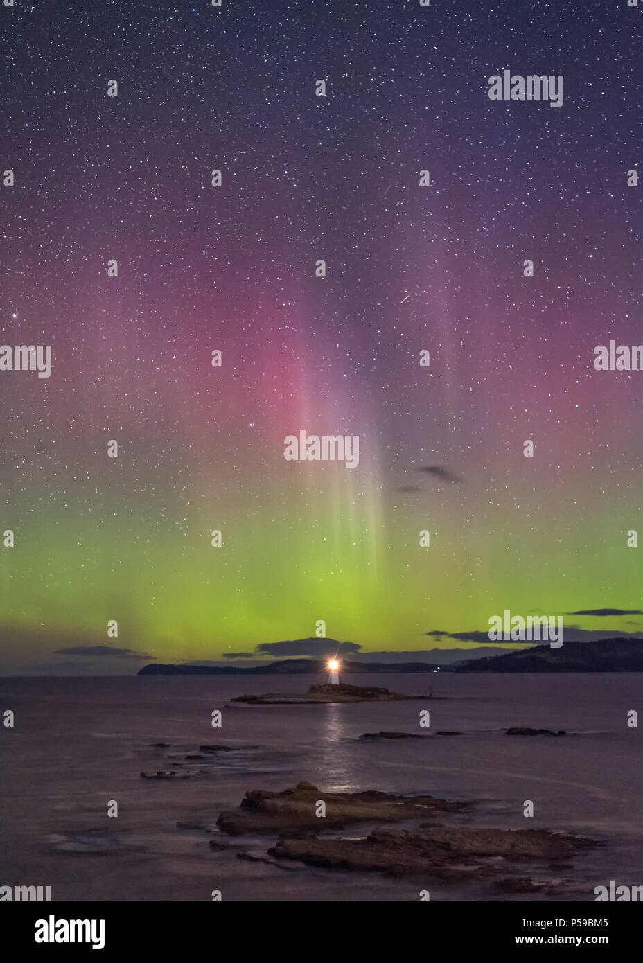 Aurora Australis over the Iron Pot Lighthouse - Stock Image