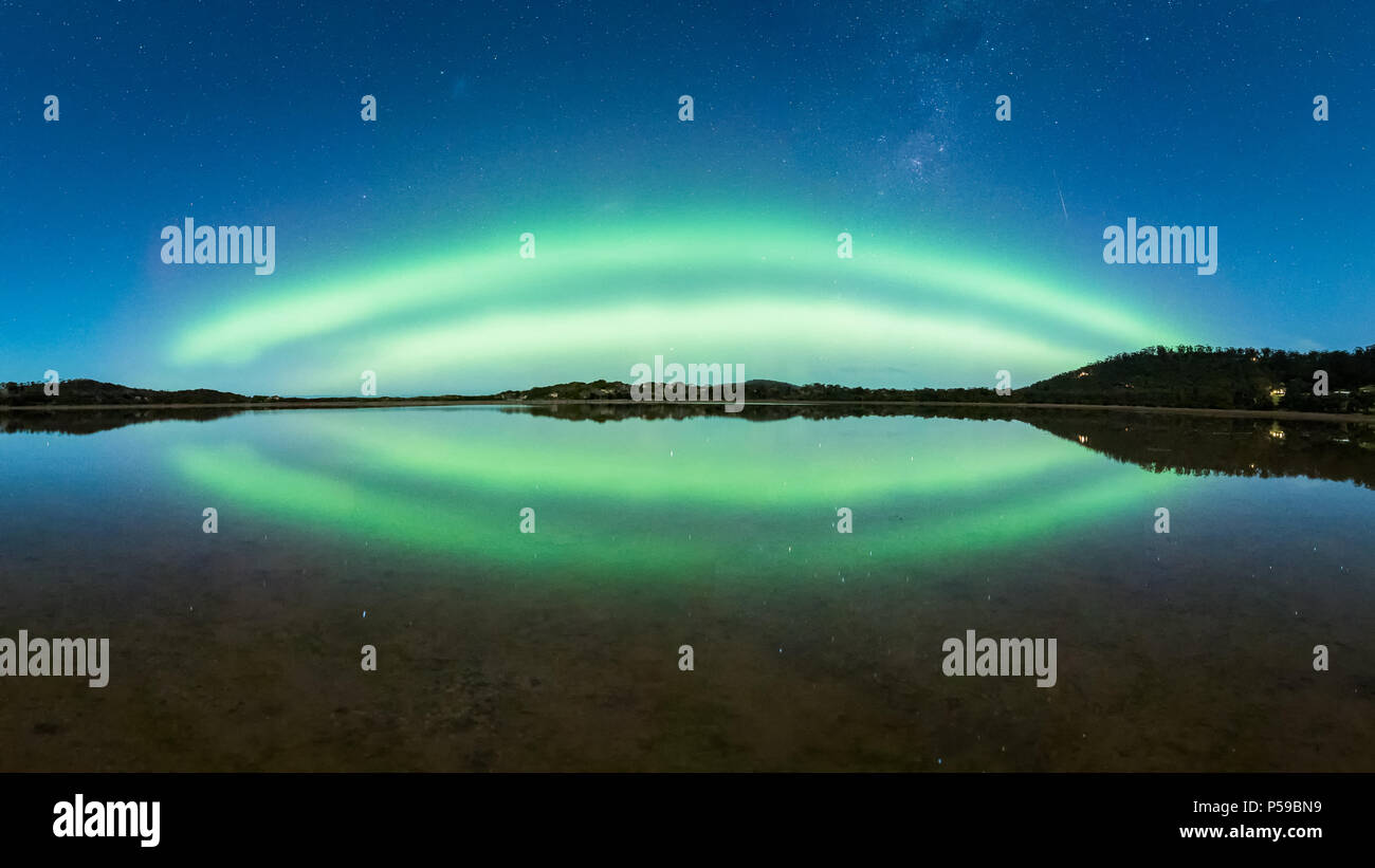 Double Arc Aurora with Reflection - Stock Image