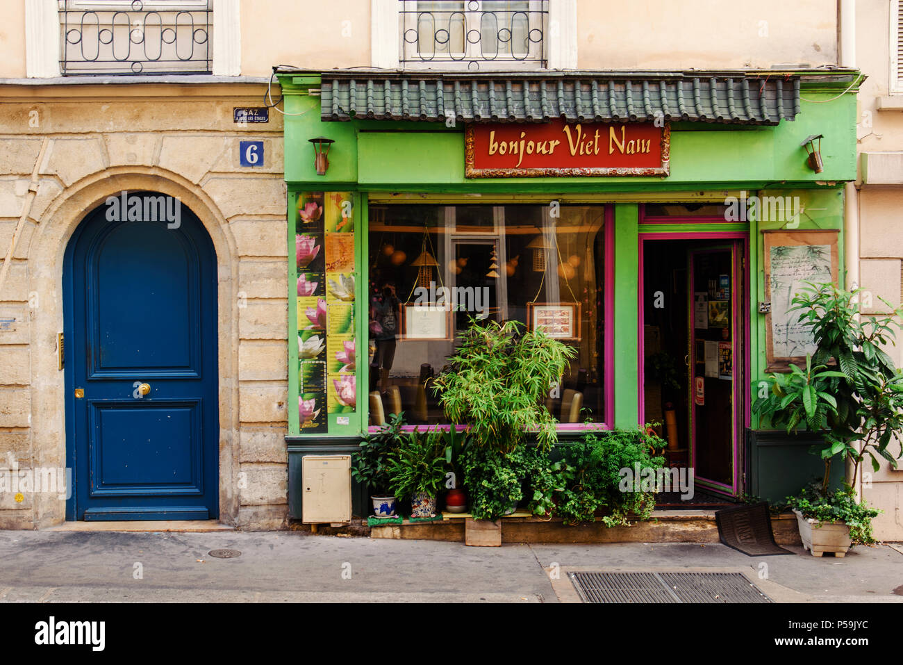 Paris, France - August 13, 2017. Parisian rue Thouin street in the 5th arrondissement and vietnamese restaurant Bonjour Vietnam showcase with greenery - Stock Image