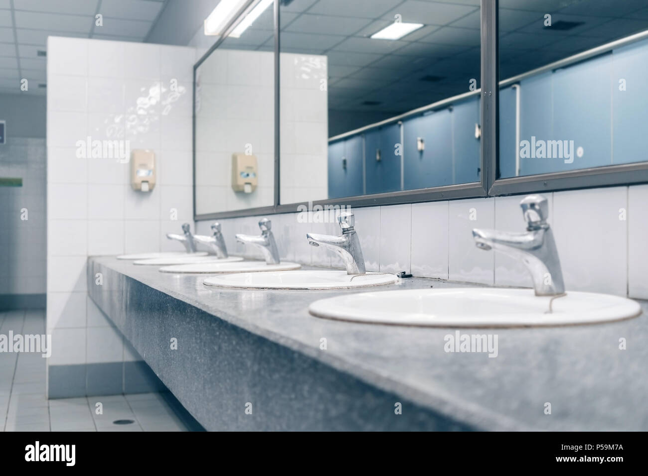 Public toilet and Bathroom interior with white wash basin and sink ...