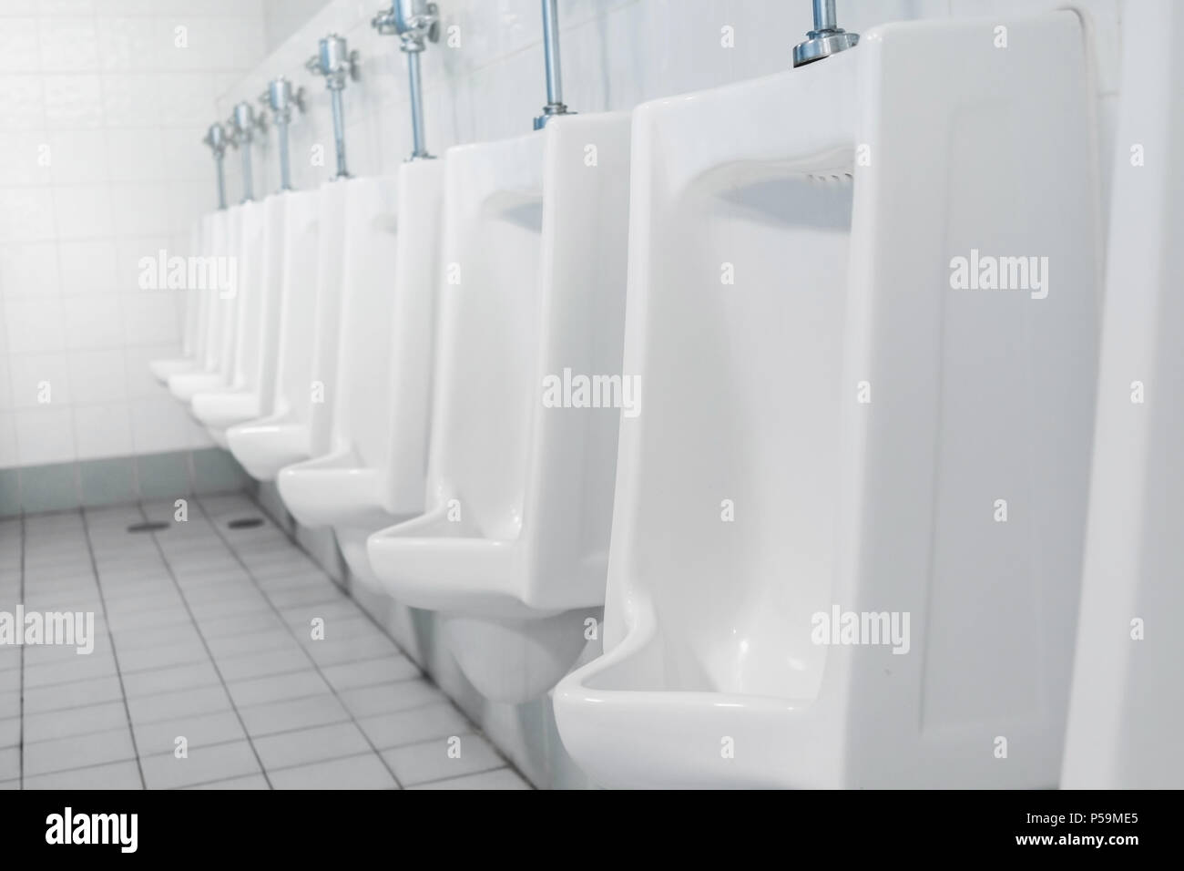 Public Toilet And Bathroom Interior With White Urinals Close Up