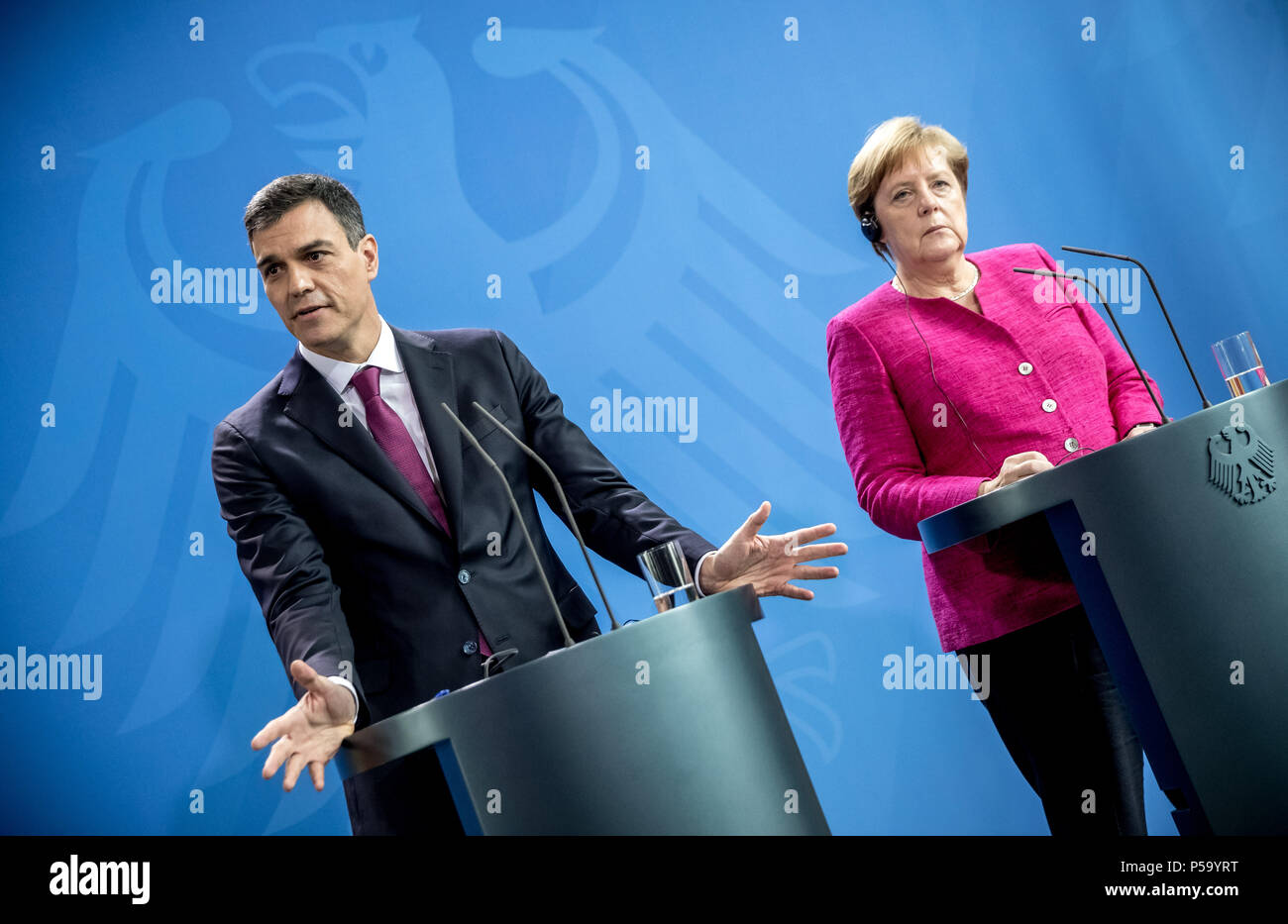 Germany, Berlin. 26th June, 2018. German chancellor Angela Merkel (Christian Democratic Union - CDU) stands next to the Spanish head of state Pedro Sanchez during a press conference. They met for bilateral talks at the federal chancellery in Berlin. Credit: Michael Kappeler/dpa/Alamy Live News - Stock Image