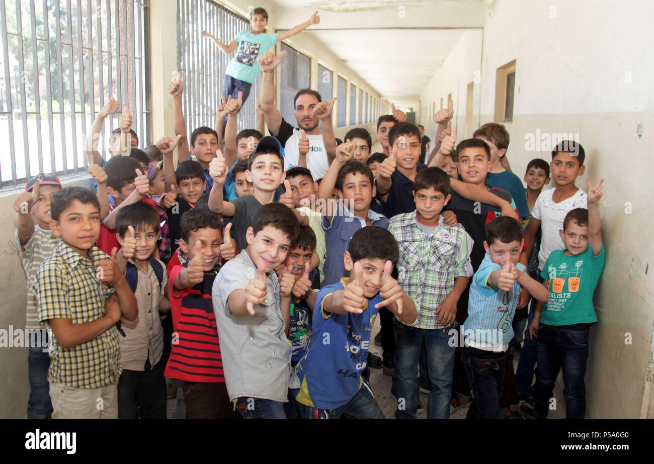526060a95c99 Syrian children react after finishing a lesson at a school in the formerly  rebel-held ...