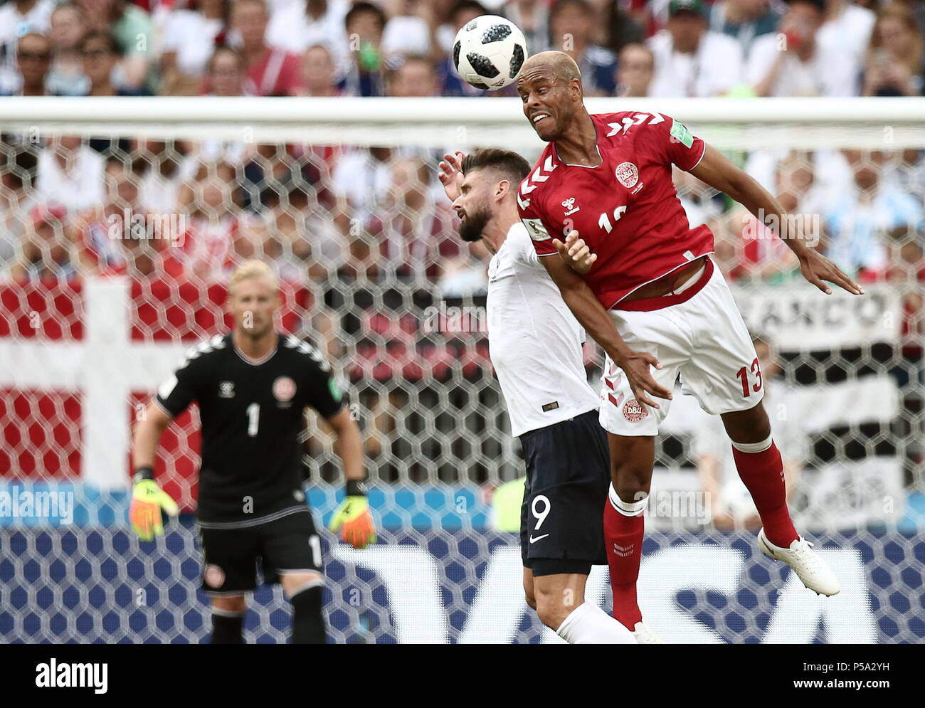 Moscow, Russia. 26th June, 2018. MOSCOW, RUSSIA - JUNE 26, 2018: Denmark's Mathias Jorgensen and France's Olivier Giroud (R-L) in their 2018 FIFA World Cup Group C Round 3 match at Luzhniki Stadium. Valery Sharifulin/TASS Credit: ITAR-TASS News Agency/Alamy Live News - Stock Image
