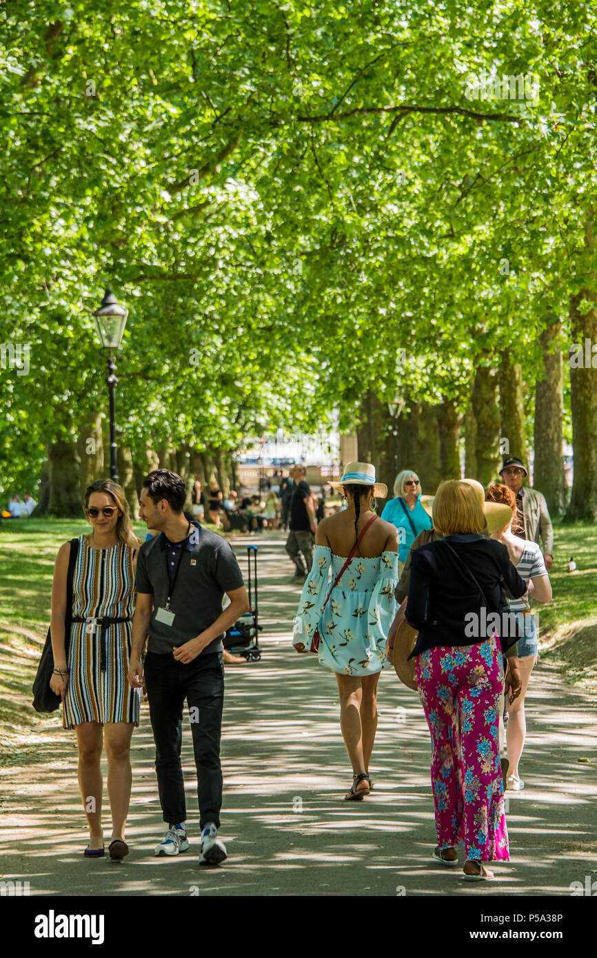 Green Park, London. 26th Jun, 2018. UK Weather: Tourists and workers from nearby offices take advantage of teh relative cool on the sun-dappled tree lined avenues - People enjoy their lunch break in the hot and sunny conditions in Green Park.. Credit: Guy Bell/Alamy Live News Stock Photo