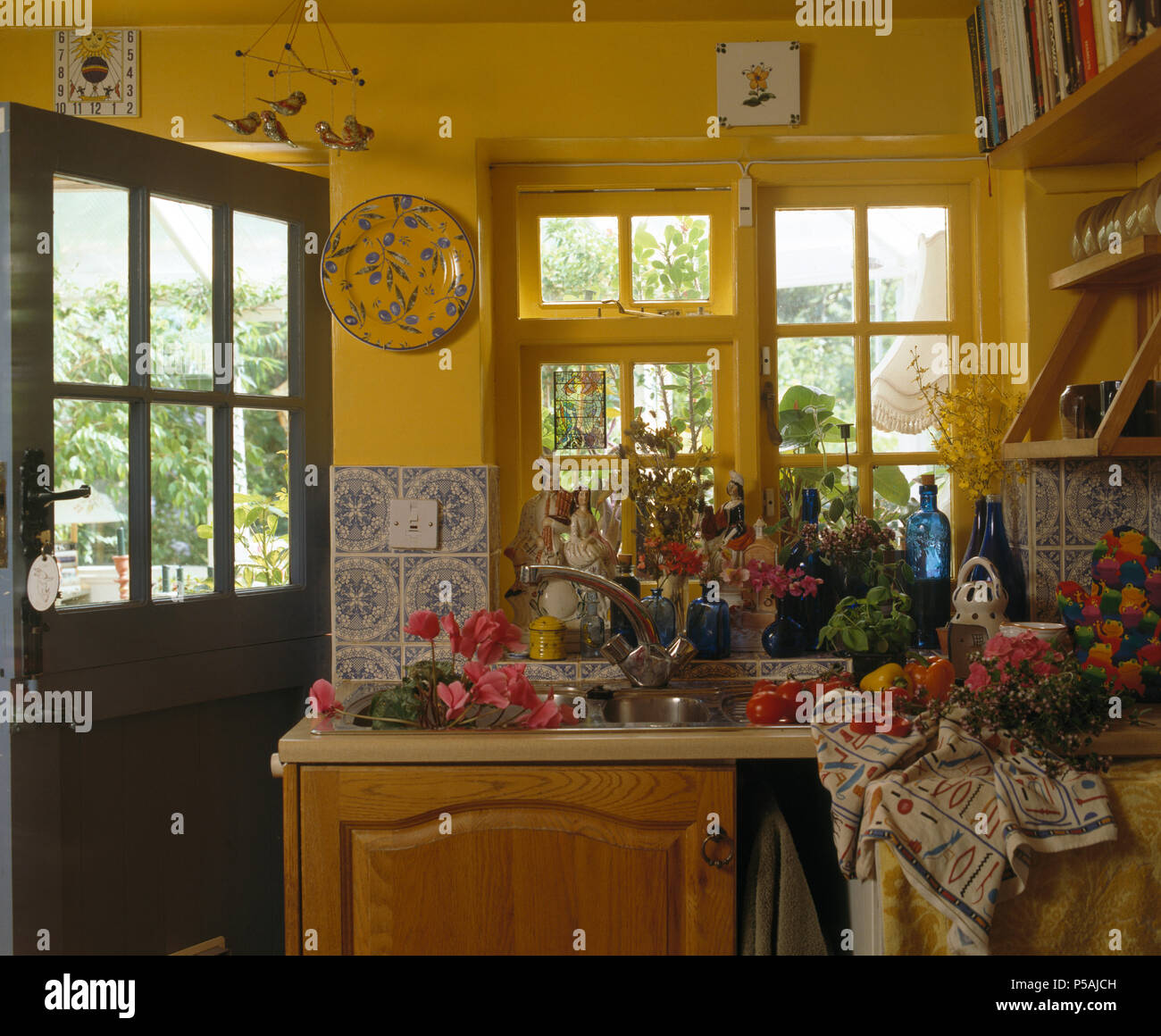 Summer Flowers In Sink Below Window In Yellow Cottage