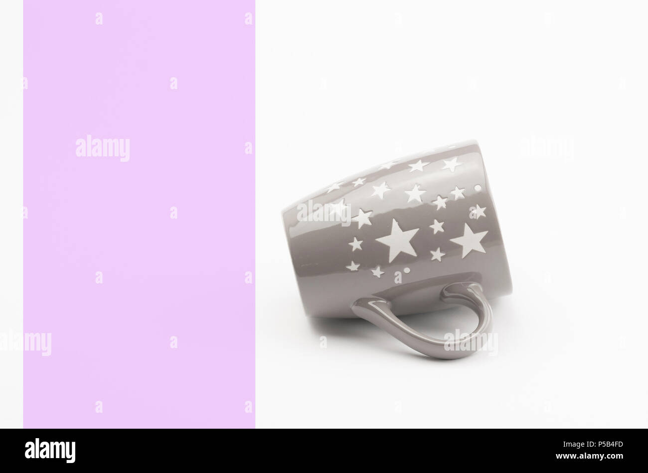 modern design decorated ceramic tea coffee mug on a white background - Stock Image
