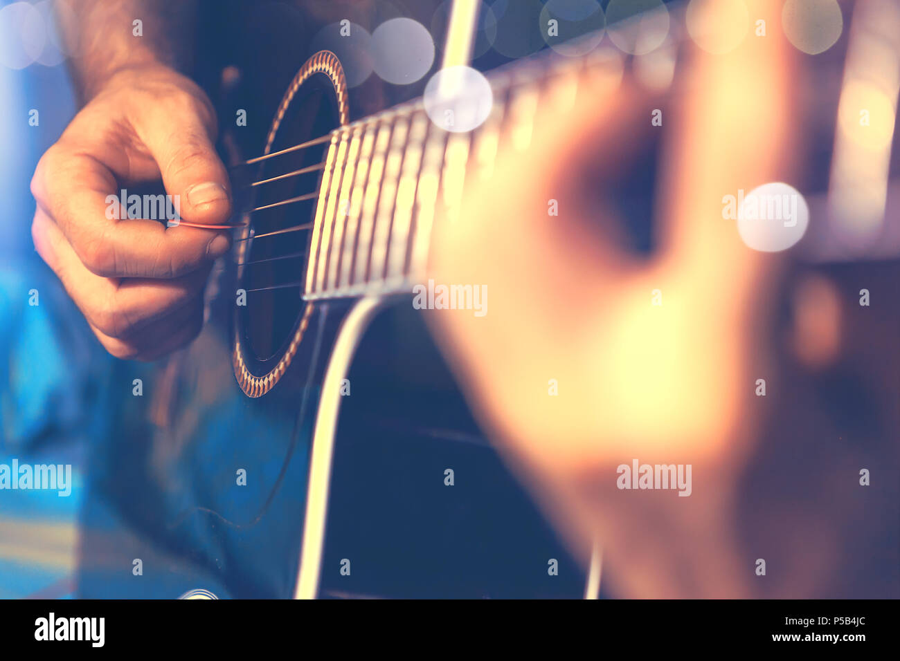 Acoustic guitar and guitarist detail - Stock Image