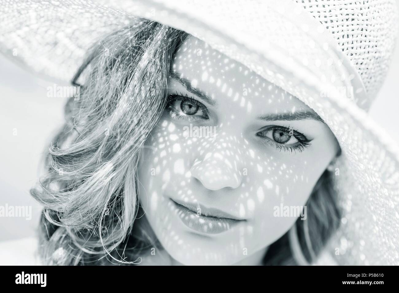 Beauty teenager with hat on head face closeup portrait looking at camera serious fine-art fineart artistic arty Stock Photo