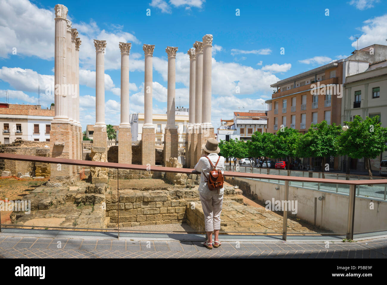 Rear view of a mature middle aged woman solo traveler visiting the ruins of an ancient Roman temple in Cordoba, Andalucia, Spain, - Stock Image