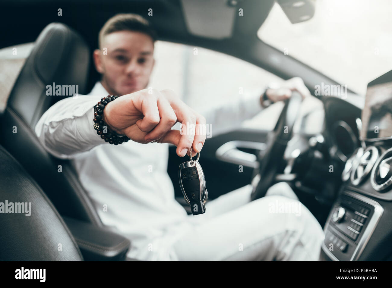 Handsome Young Man Showing Car Keys In His Newly Bought Auto Sitting In The Luxury Vehicle Stock Photo Alamy