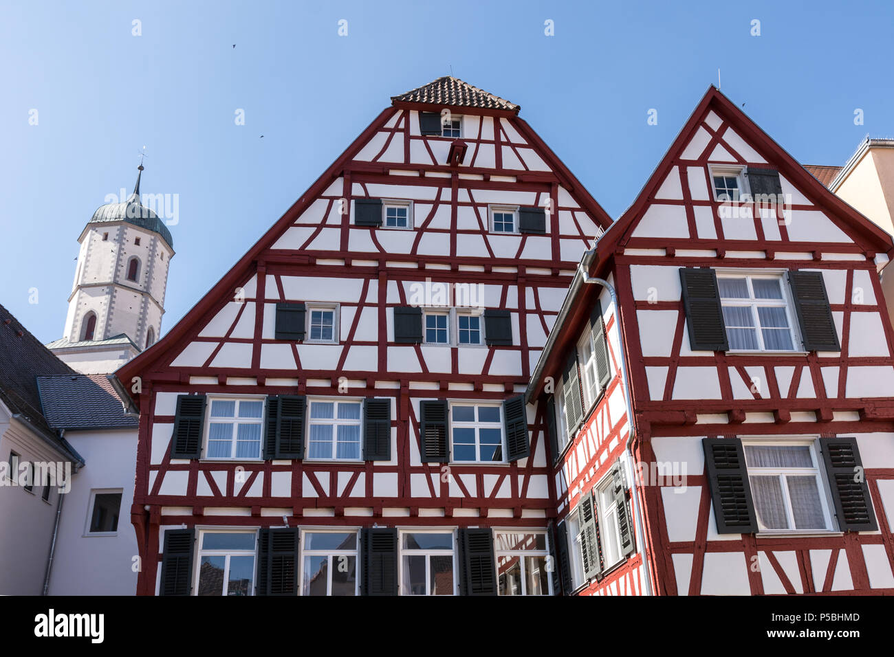 half-timbered houses with church tower in Biberach Stock Photo