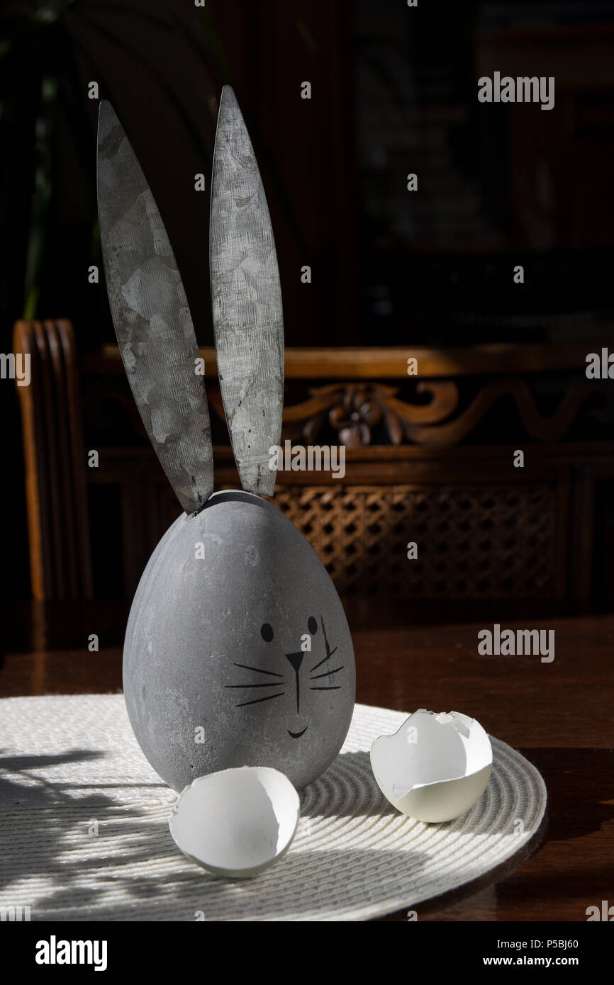 Easter table with Easter bunny and eggshells Stock Photo
