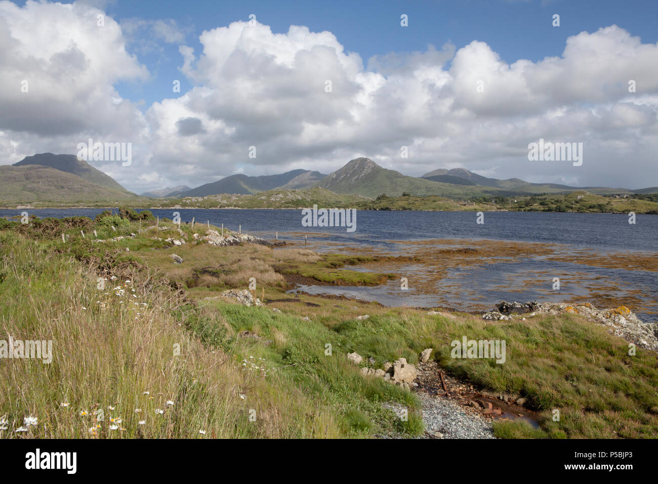 Looking towards the Twelve Bens (or Twelve Pins) Mountains from the Connemara Loop Road on the Renvyle Peninsula - Stock Image