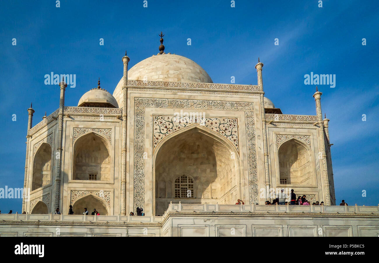 The Taj Mahal is an ivory-white marble mausoleum on the south bank of the Yamuna river. It was commissioned in 1632 by the Mughal emperor, Shah Jahan - Stock Image
