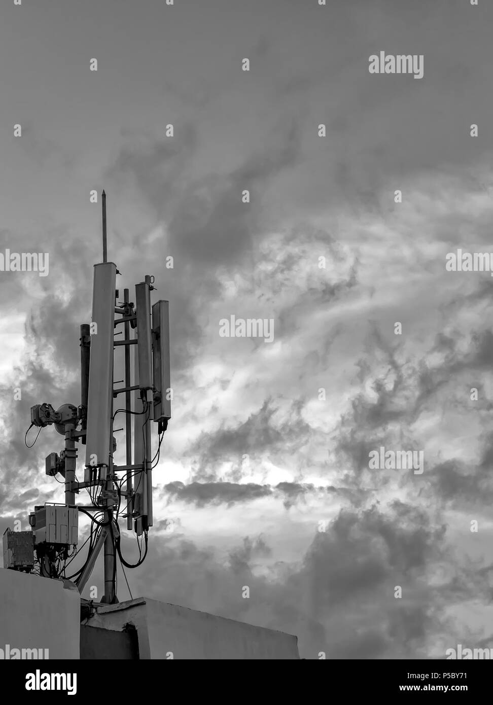 Antenna of GSM Transmitter on the roof of building. Close up. Black and white Stock Photo