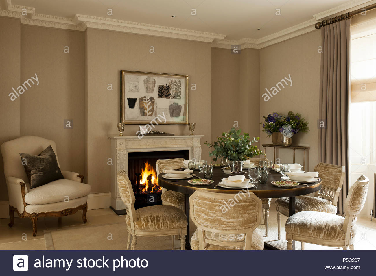 Country Style Dining Room With Lit Fire