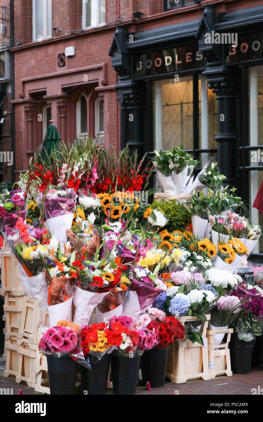 Bouquets of flowers for sale outside Boodies Jewellery Shop, Grafton Street, Dublin, Ireland. Stock Photo