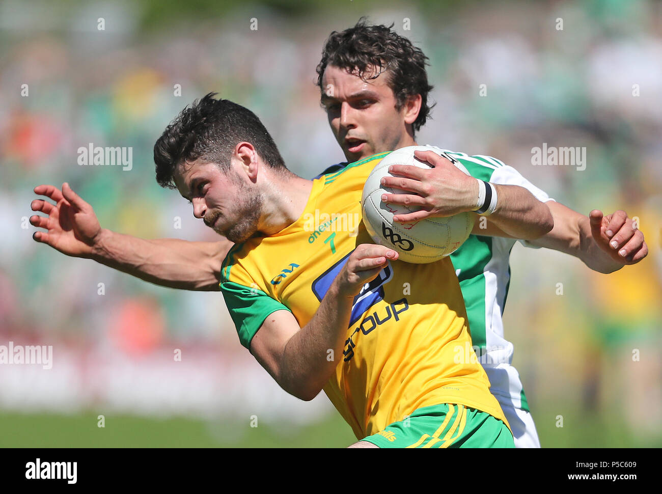 Fermanagh's Eamon McHugh and Donegal's Ryan McHugh during the GAA Ulster Final in Clones, Co Monaghan, Ireland. - Stock Image