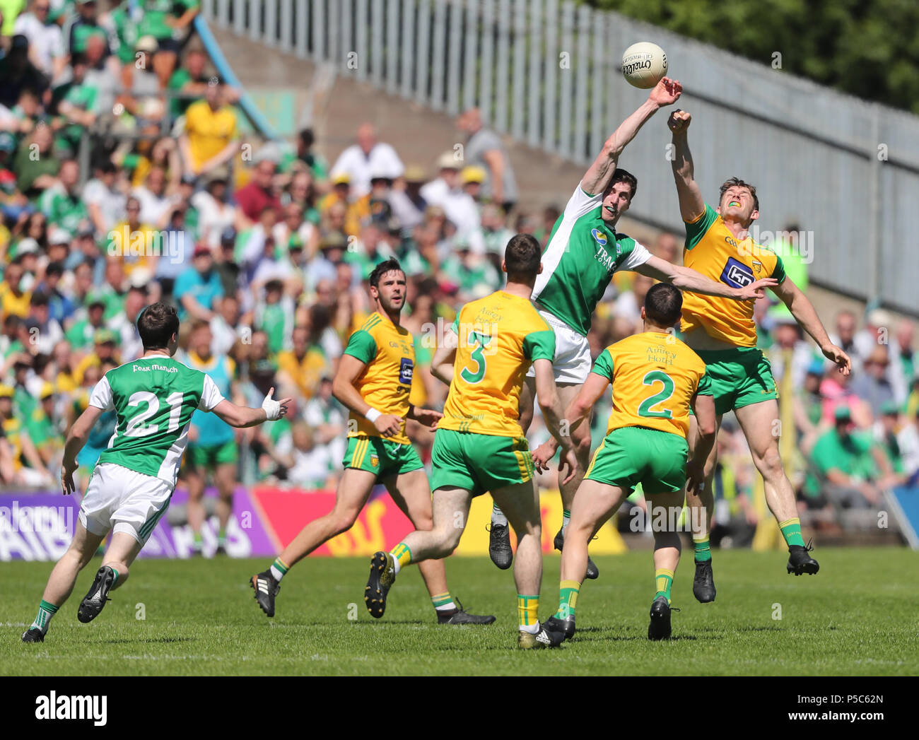 Fermanagh's Eoin Donnelly and Donegal's Hugh McFadden jump for the ball during the GAA Ulster Final in Clones, Co Monaghan, Ireland. - Stock Image