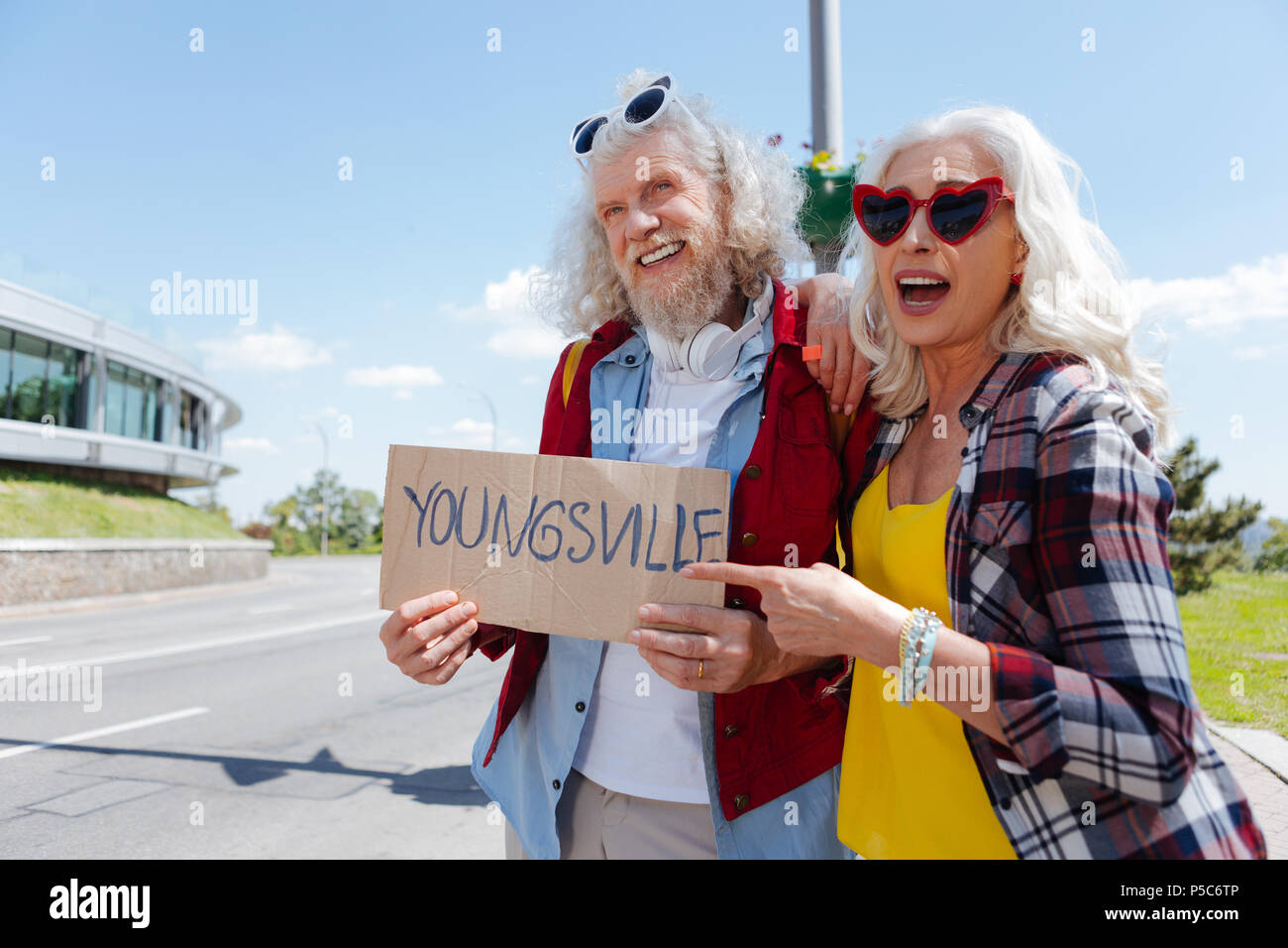 Joyful delighted couple going to youngsville - Stock Image