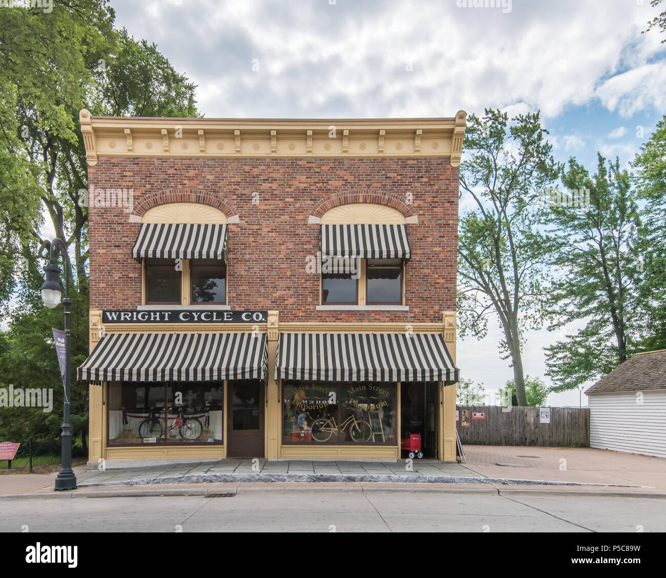 DEARBORN, MI/USA - JUNE 16, 2018: Wright Cycle Co. building at The Henry Ford (THF) Motor Muster car show, held at Greenfield Village, near Detroit. - Stock Image