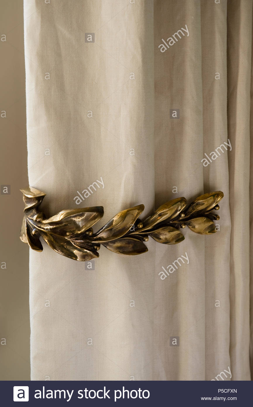 Ornate curtain holder - Stock Image