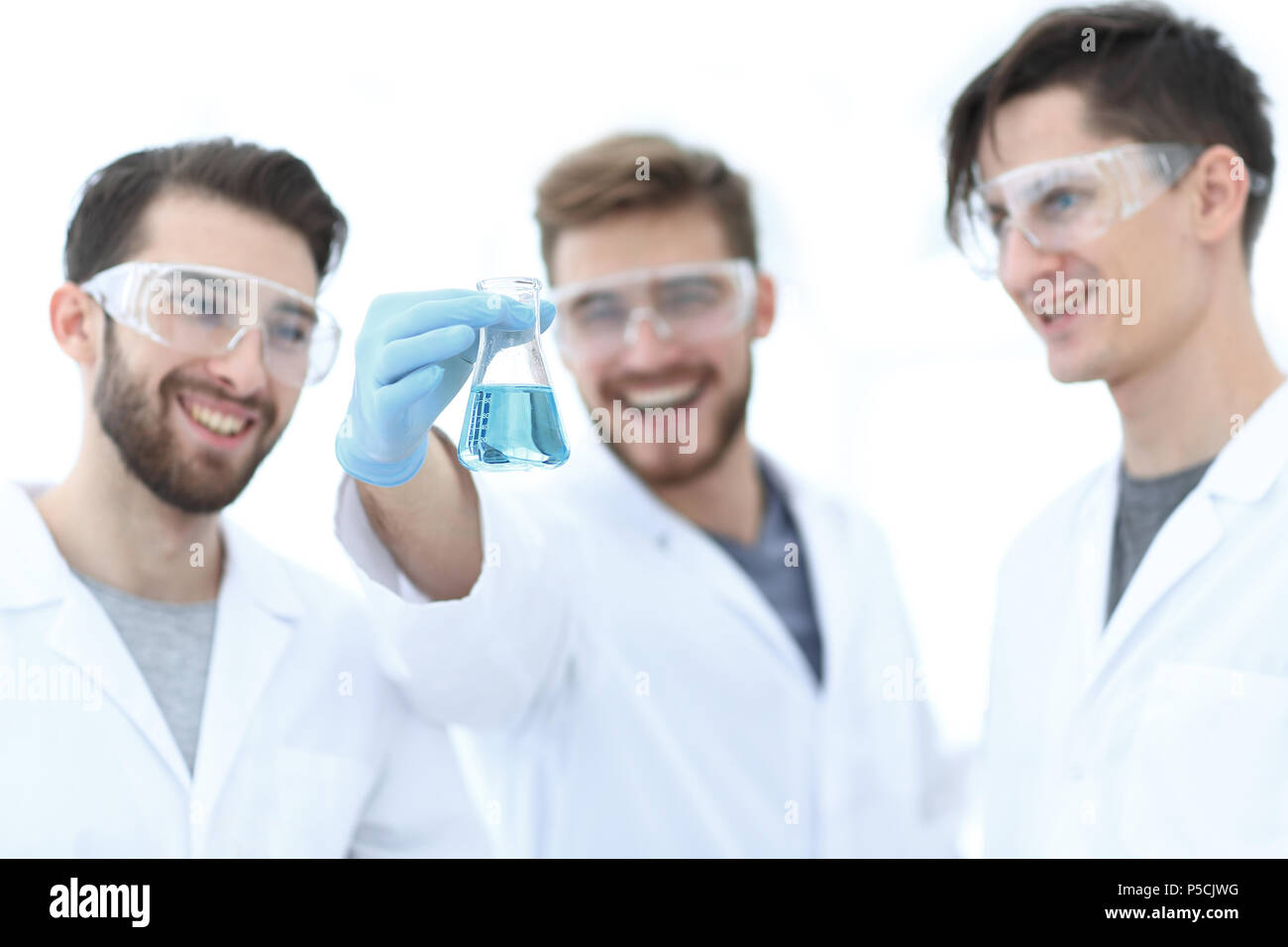 scientists rejoice at the result of their work. - Stock Image