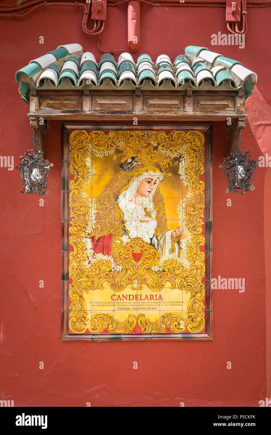 Portrait of The Virgen de la Candelaria composed of azulejo tiles sited on a wall in the Calle Compas de San Francisco in Cordoba, Andalucia, Spain. - Stock Image