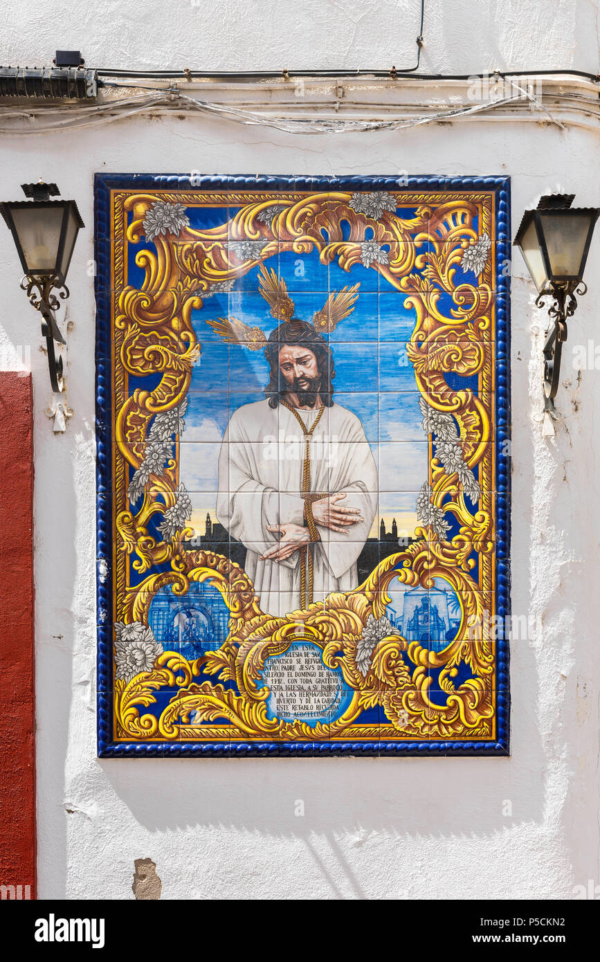 Tiles Spain, a portrait of Jesus Christ composed of azulejo tiles sited on a wall in the Calle Compas de San Francisco in Cordoba, Andalucia, Spain. - Stock Image